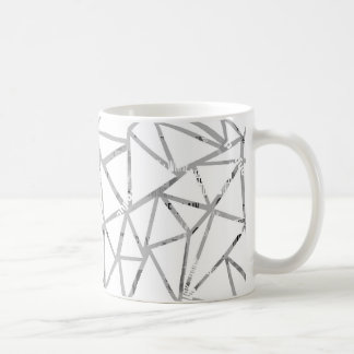 Structure of triangles with a collage of fonts coffee mug