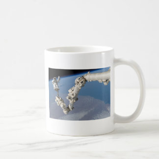 STS-114_Steve_Robinson_on_Canadarm2.jpg Coffee Mug