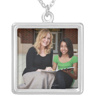 student and teacher outside on steps at school silver plated necklace