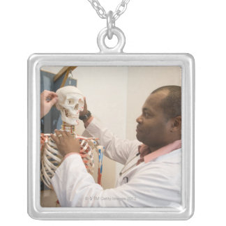 Student doctors studying anatomy on a skeleton silver plated necklace