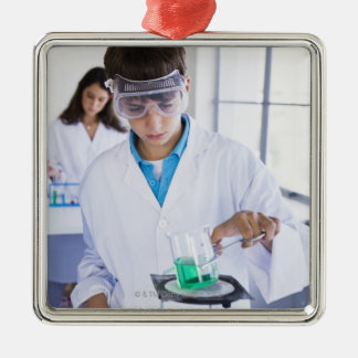 Student doing science experiment 2 Silver-Colored square decoration