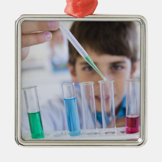 Student doing science experiment 3 christmas ornament
