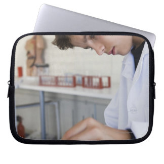 Student doing science experiment laptop sleeve
