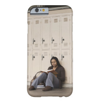 Student leaning on school lockers studying barely there iPhone 6 case