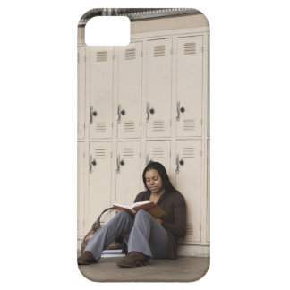 Student leaning on school lockers studying iPhone 5 cover