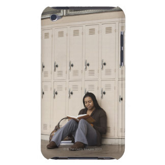 Student leaning on school lockers studying iPod touch cases