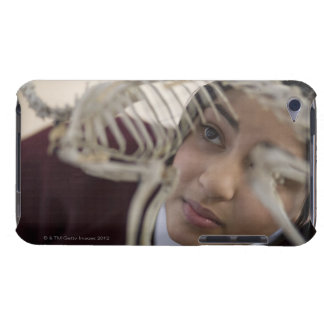 Student looking at animal skeleton barely there iPod cases