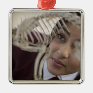 Student looking at animal skeleton christmas ornament