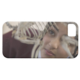 Student looking at animal skeleton iPhone 5 cover