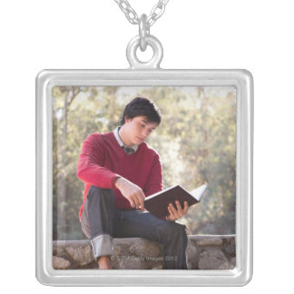 Student Reading Book and Sitting on Stone Wall Square Pendant Necklace