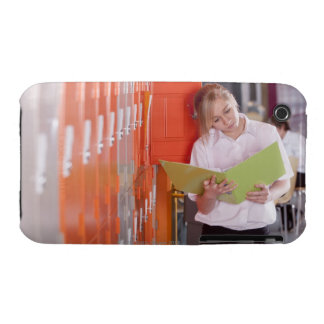 Student removing binder from school locker iPhone 3 Case-Mate cases