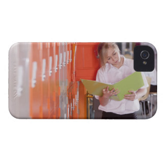Student removing binder from school locker iPhone 4 Case-Mate case