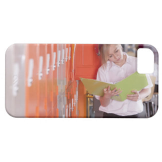 Student removing binder from school locker iPhone 5 covers