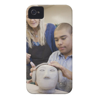 Student sculpting bust in classroom iPhone 4 case