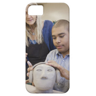 Student sculpting bust in classroom iPhone 5 case