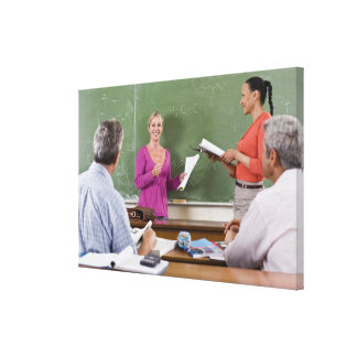 Student talking to class and standing by teacher gallery wrapped canvas