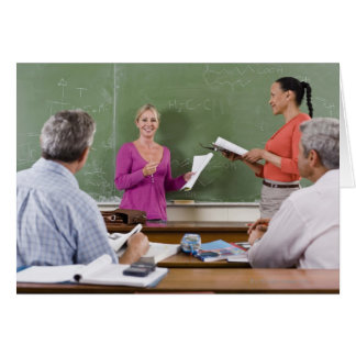 Student talking to class and standing by teacher card