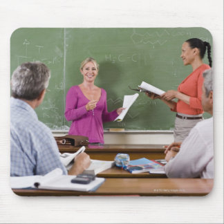 Student talking to class and standing by teacher mouse mat