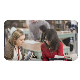 Student talking to librarian in school library iPod touch cover