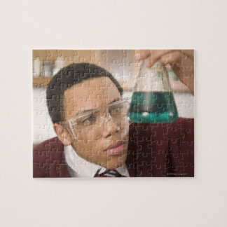 Student watching chemistry experiment jigsaw puzzle