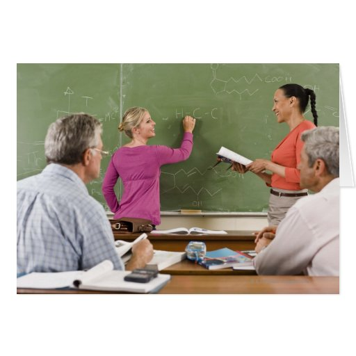 Students and teacher in classroom greeting card