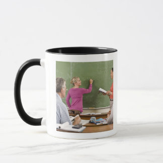 Students and teacher in classroom mug