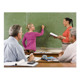 Students and teacher in classroom postcard