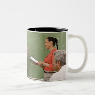 Students and teacher in classroom Two-Tone mug
