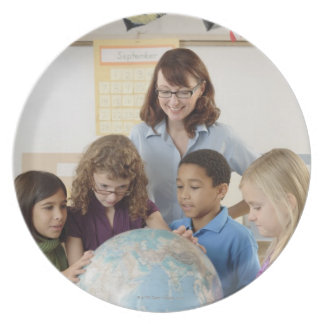 students and teacher with globe plate