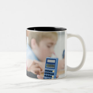 Students doing math work in classroom Two-Tone mug