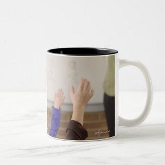 students in classroom Two-Tone mug