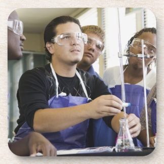 Students performing experiment in chemistry lab coaster