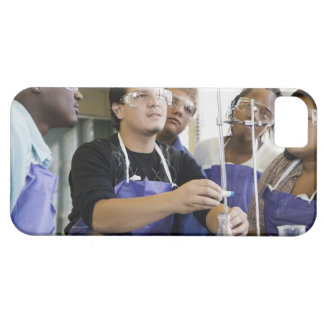 Students performing experiment in chemistry lab iPhone 5 cover