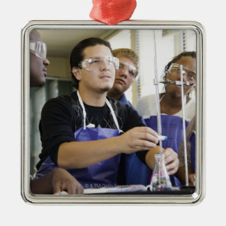 Students performing experiment in chemistry lab Silver-Colored square decoration