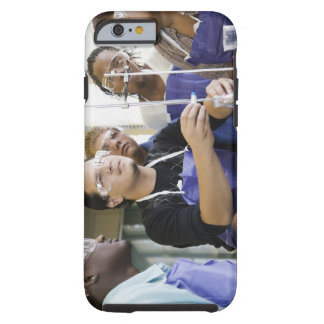 Students performing experiment in chemistry lab tough iPhone 6 case