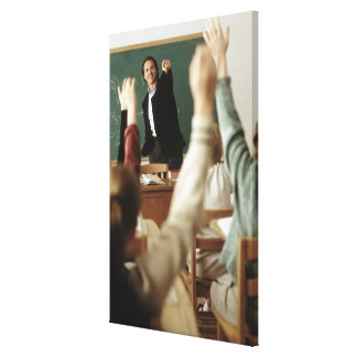 Students raising their hands in classroom canvas print