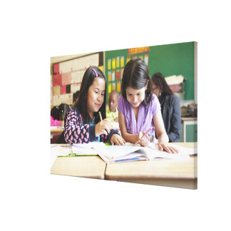Students working together in classroom canvas print