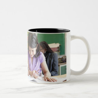 Students working together in classroom Two-Tone coffee mug