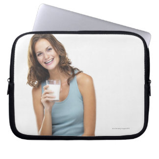 Studio portrait of attractive young woman laptop sleeve