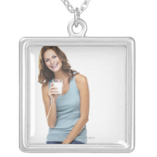 Studio portrait of attractive young woman silver plated necklace