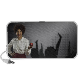 Studio portrait of female teacher with shadows portable speakers