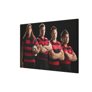 Studio portrait of male rugby team canvas print