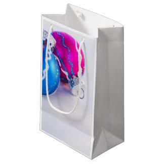 Studio shot of christmas baubles small gift bag
