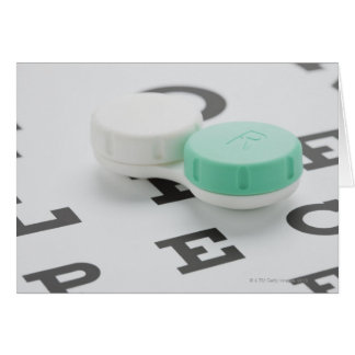 Studio shot of contact lens case on eye chart card