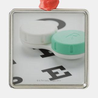 Studio shot of contact lens case on eye chart christmas ornament