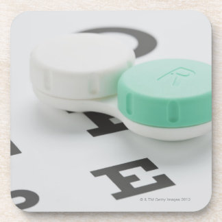 Studio shot of contact lens case on eye chart coaster