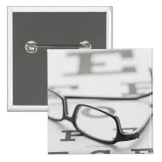 Studio shot of eyeglasses on eye chart 15 cm square badge