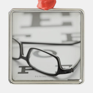 Studio shot of eyeglasses on eye chart Silver-Colored square decoration