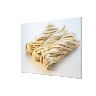 Studio shot of fresh linguini pasta canvas print