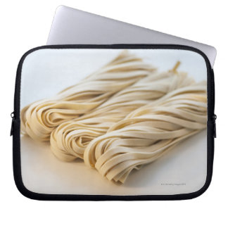 Studio shot of fresh linguini pasta laptop sleeve